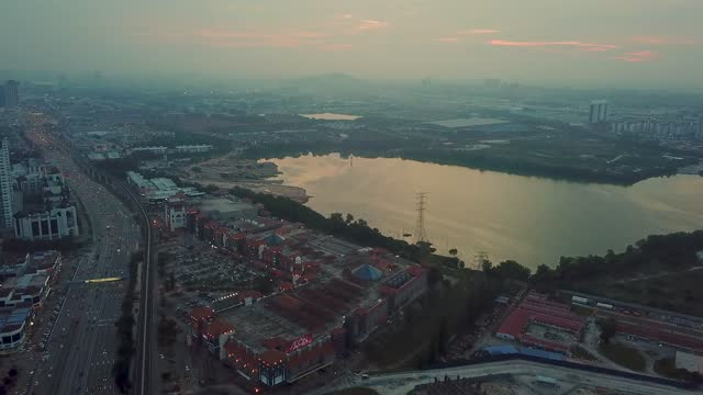vidéos et rushes de drone point of view sunset in nightlife town city - malaisie