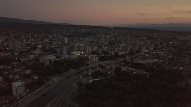 drone point of view town of nis in dusk - serbia stock videos & royalty-free footage