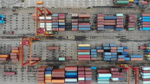 drone point view of busy industrial port - anchored stock videos & royalty-free footage