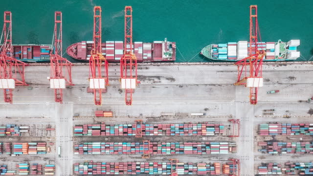 t/l pan drone point view of busy industrial port with containers ship - container stock videos & royalty-free footage