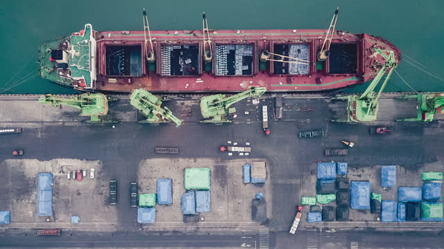 t/l pan drone point view of cargo ship in the port - anchored stock videos & royalty-free footage