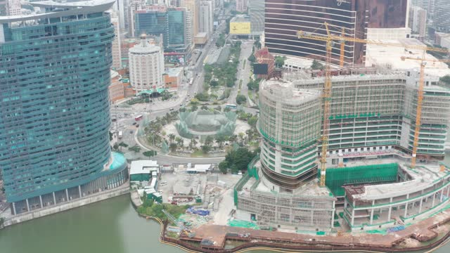 drone point view of casino under construction - macao stock-videos und b-roll-filmmaterial