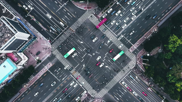 t/l drone point view of city street crossing - road junction stock videos & royalty-free footage