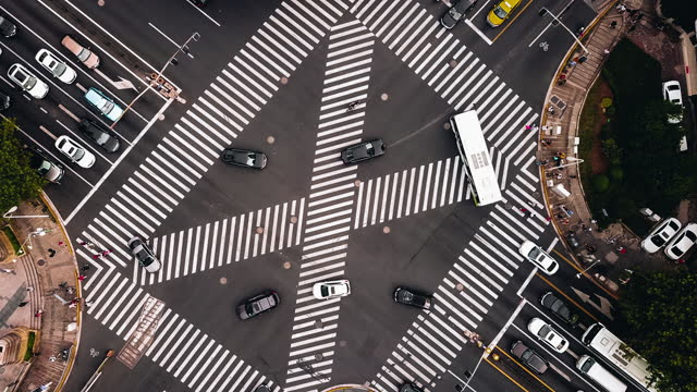 t/l drone point view of city street crossing - zebra crossing stock videos & royalty-free footage