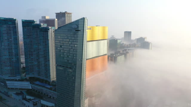 drone point view of modern skyscraper, macao, china - macao stock videos & royalty-free footage