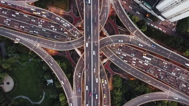 drone point view of overpass and city traffic at dusk - complexity stock videos & royalty-free footage