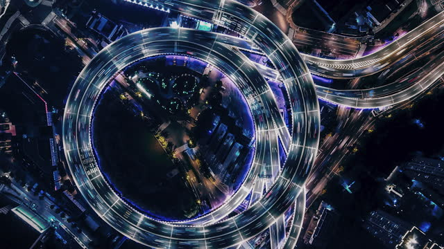 t/l pan drone point view of overpass and city traffic at night - east asia stock videos & royalty-free footage