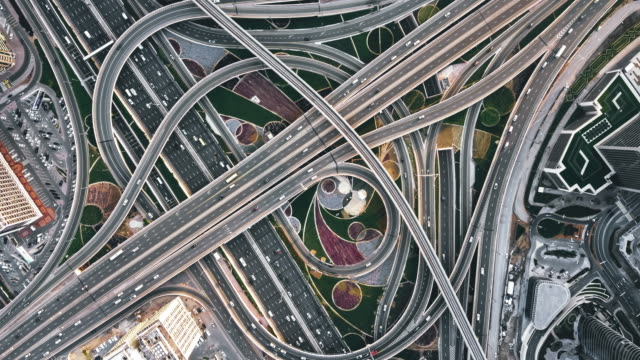 t/l drone point view of road intersection at daytime / dubai, uae - elevated road stock videos & royalty-free footage