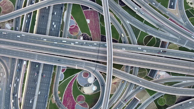 drone point view of road intersection / dubai, uae - motorway stock videos & royalty-free footage