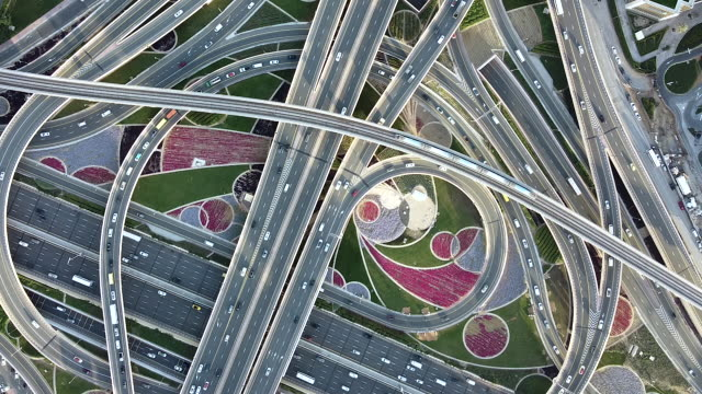 pan drone point view of road intersection / dubai, uae - underground rail stock videos & royalty-free footage