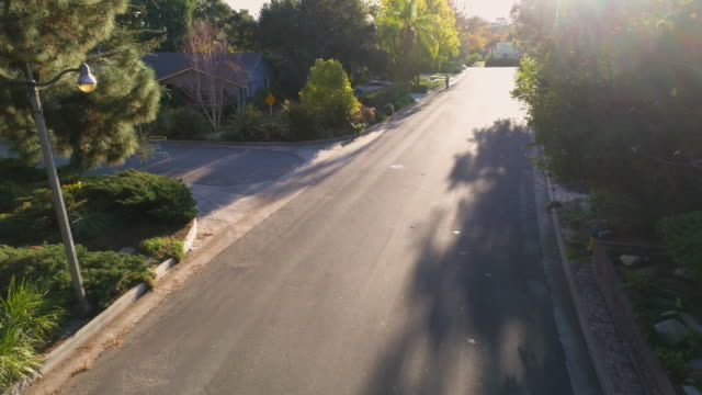 drone pullback on california residential street at sunset in 4k - pasadena california stock videos & royalty-free footage
