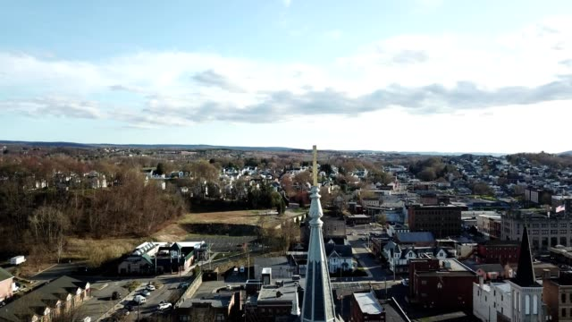 a drone pulls away from church steeples in pittston pennsylvania - catholicism stock videos and b-roll footage