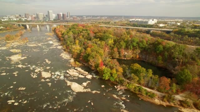 drone - revealing city skyline and river island in autumn - richmond virginia stock videos & royalty-free footage