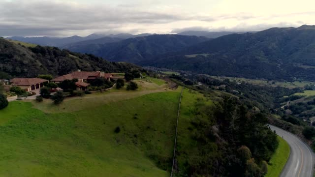 a drone reveals a home in the mountains of carmel-by-the-sea california - carmel california stock videos & royalty-free footage