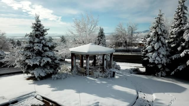 a drone reveals a snow covered gazebo in lakewood colorado - colorado stock videos & royalty-free footage