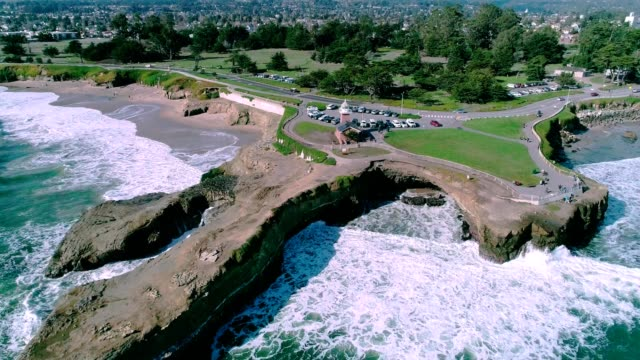 a drone reveals point santa cruz lighthouse in california - santa cruz california stock videos and b-roll footage