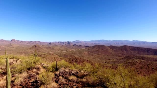 A drone reverses over a desert mountain in Phoenix Arizona