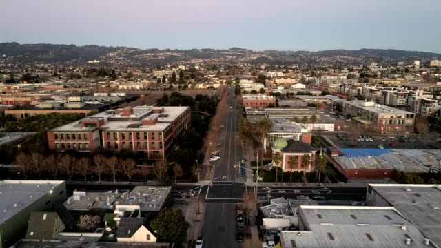 a drone reverses over park avenue in emeryville california - emeryville stock videos & royalty-free footage