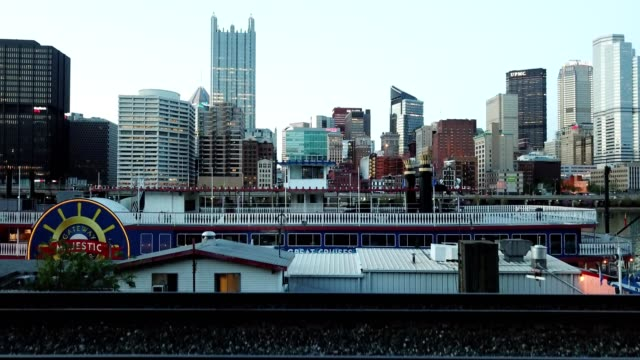 a drone rises over a ferry to view downtown pittsburgh pennsylvania - pittsburgh video stock e b–roll