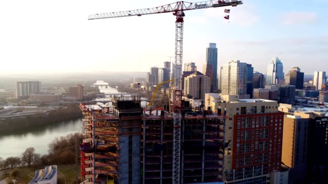 a drone rises over a high rise construction project in austin texas - austin texas stock videos & royalty-free footage