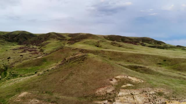 a drone rises over a hill line in lakewood colorado - colorado stock videos & royalty-free footage