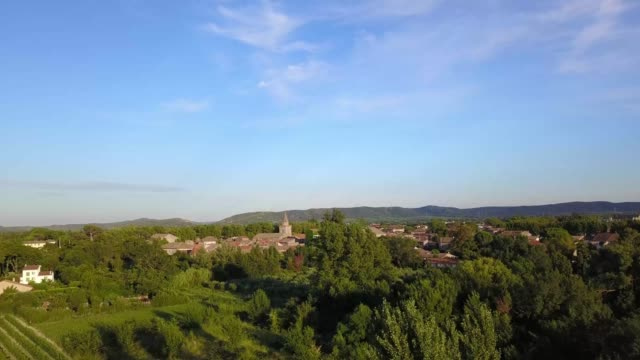 a drone rises over a small village with a church in languedoc region of canet d'aude france - aude stock videos & royalty-free footage