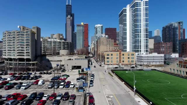 a drone rises over a street to view downtown chicago illinois - dronebase stock videos and b-roll footage