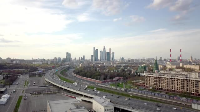 A drone rises over a street to view downtown Moscow City Russia