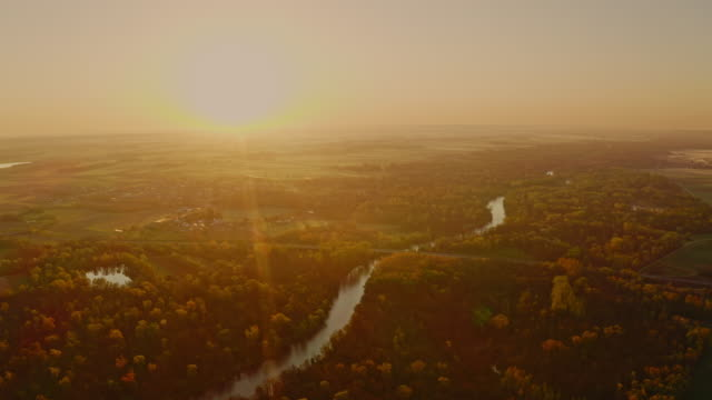aerial drone rising above the river at sunrise - tranquil scene stock videos & royalty-free footage
