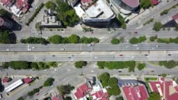 Drone rising over a road junction in Guadalajara, zenith view