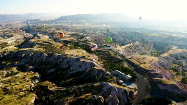 drone shoot 4k: aerial view of hot air balloons over cappadocia at sunrise,turkey - country geographic area stock videos & royalty-free footage