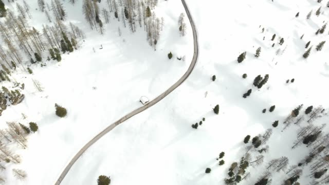 drone shoot - empty mountain road trough winter fairytale - austria stock videos & royalty-free footage
