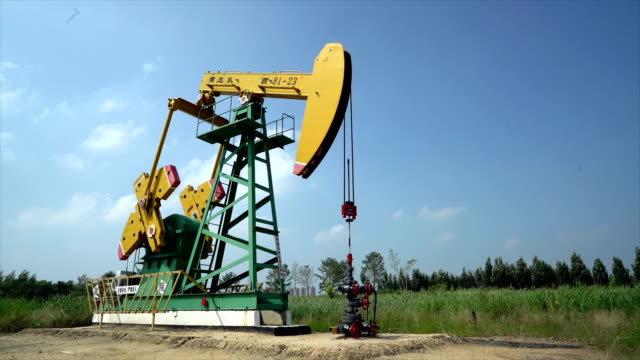 drone shooting china's daqing oilfield - removing stock videos & royalty-free footage