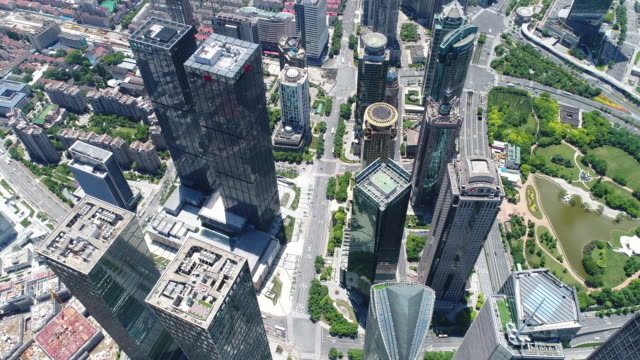 drone shot: 4k aerial view of lujiazui district in shanghai - lujiazui stock videos & royalty-free footage