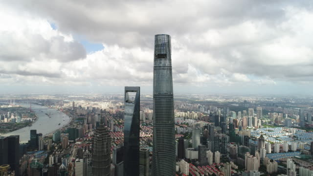 drone shot: 4k aerial view of lujiazui financial district in shanghai. - shanghai world financial center stock videos & royalty-free footage
