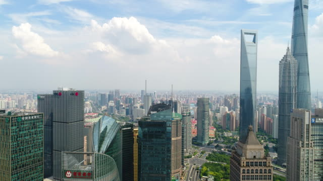 drone shot: 4k aerial view of lujiazui financial district in shanghai. - pacific city stock videos & royalty-free footage