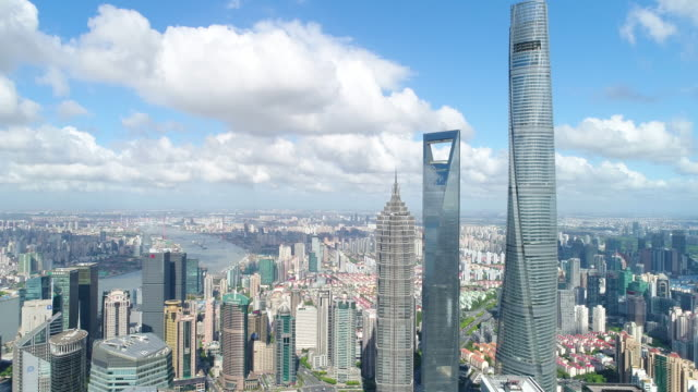 drone shot: 4k aerial view of lujiazui financial district in shanghai. - lujiazui stock videos & royalty-free footage