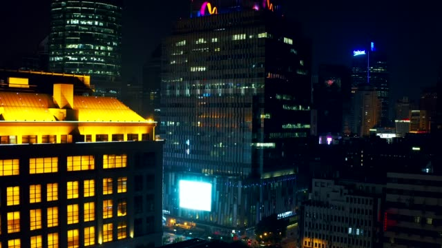 drone shot 4k aerial view of shanghai financial district building with led advertising screen view near the oriental pearl tower in shanghai, china. night time - lockdown stock videos & royalty-free footage