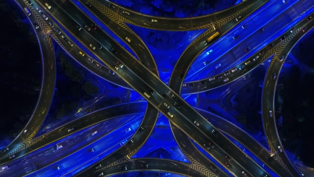 Drone shot: 4K Aerial view of Shanghai highway at night.