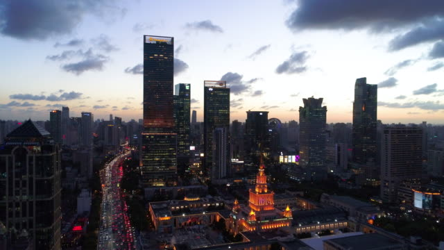 Drone shot: 4K Aerial view of Shanghai skyline at dramatic sunset.