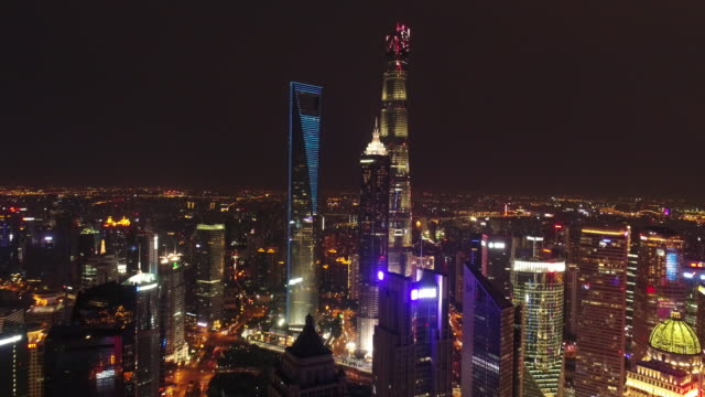 Drone shot: 4K Aerial view of Shanghai skyline at night.