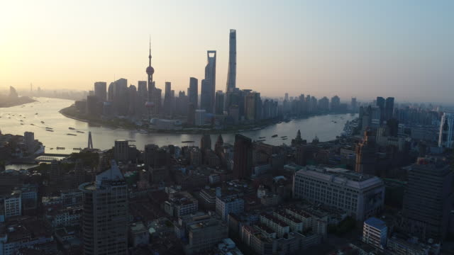 drone shot: 4k aerial view of shanghai skyline at sunrise. - east china stock videos & royalty-free footage