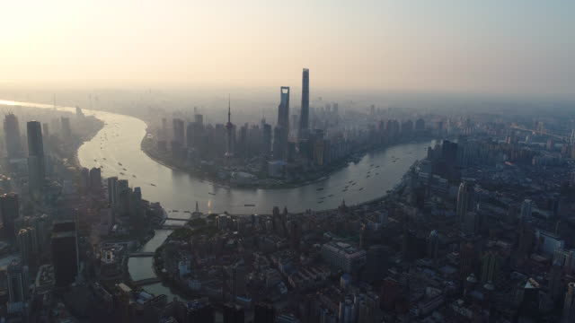 Drone shot: 4K Aerial view of Shanghai skyline at sunrise.
