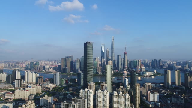 Drone shot: 4K Aerial view of Shanghai skyline in sunny sky