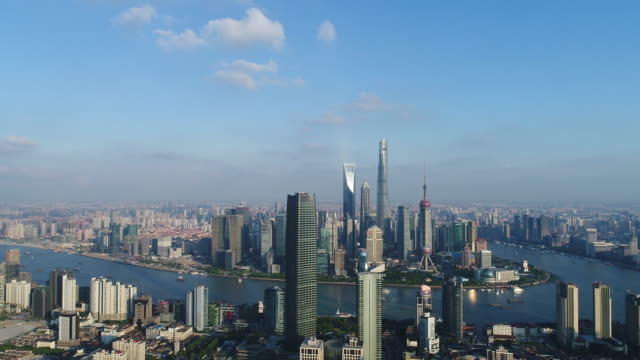 drone shot: 4k aerial view of shanghai skyline in sunny sky - lujiazui stock videos & royalty-free footage