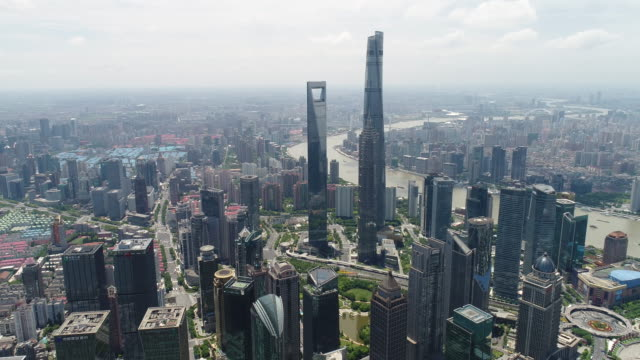 drone shot: 4k aerial view of shanghai skyline in sunny sky - shanghai world financial center stock videos & royalty-free footage