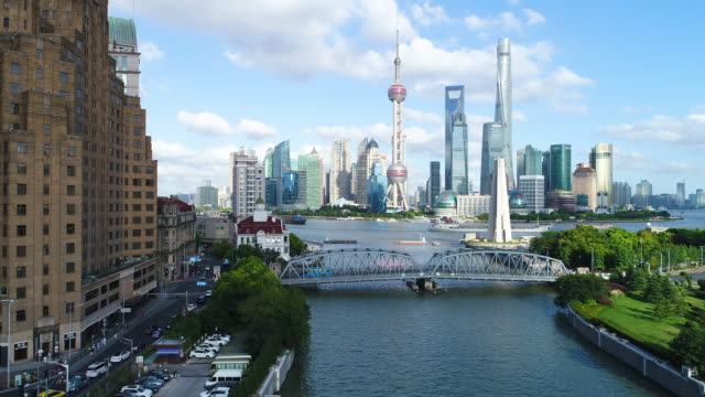 Drone shot: 4K Aerial view of Shanghai skyline in sunny sky.