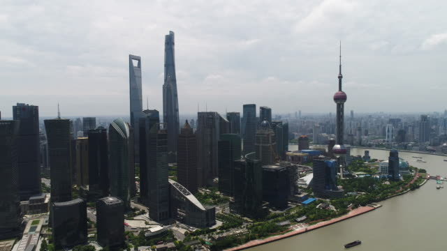 drone shot: 4k aerial view of shanghai skyline in sunny sky - east china stock videos & royalty-free footage