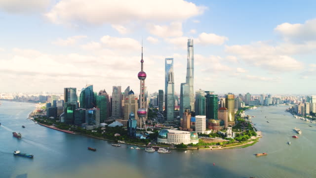 drone shot: 4k aerial view of shanghai skyline in sunny sky - river huangpu stock videos & royalty-free footage