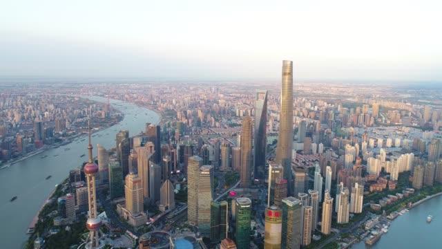 drone shot: 4k aerial view of shanghai skyline - river huangpu stock videos & royalty-free footage